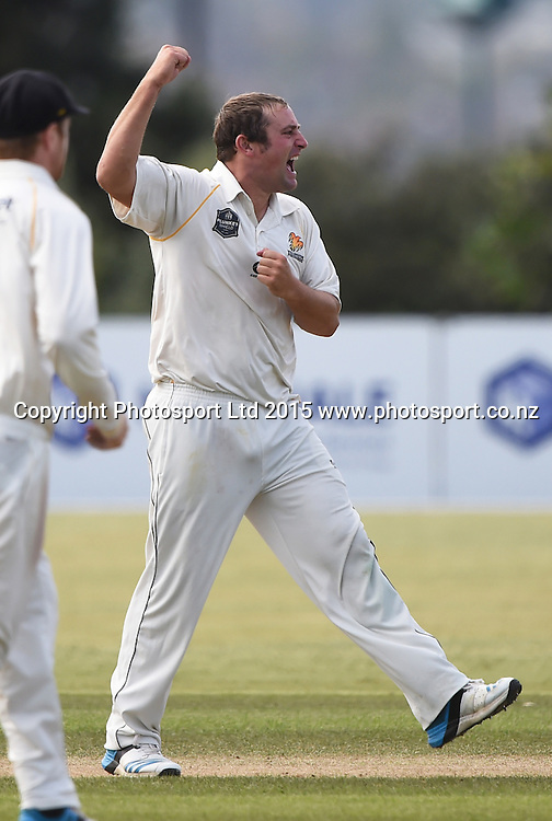 Wellington's Matt McEwan celebrates the wicket of Raval during day 3 of the Plunket Shield cricket match between Auckland and Wellington at Colin Maiden Park, Auckland, New Zealand. Thursday 19 March 2014. Copyright Photo: Andrew Cornaga / www.Photosport.co.nz