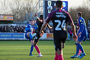 AFC Wimbledon midfielder Anthony Hartigan (8) battles for possession with Peterborough United defender Rhys Bennett (16) during the EFL Sky Bet League 1 match between AFC Wimbledon and Peterborough United at the Cherry Red Records Stadium, Kingston, England on 18 January 2020.