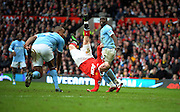 Wayne Rooney of Manchester United scores a goal from an overhead kick during the Barclays Premier League match between Manchester United and Manchester City at Old Trafford on February 12, 2011 in Manchester, England.