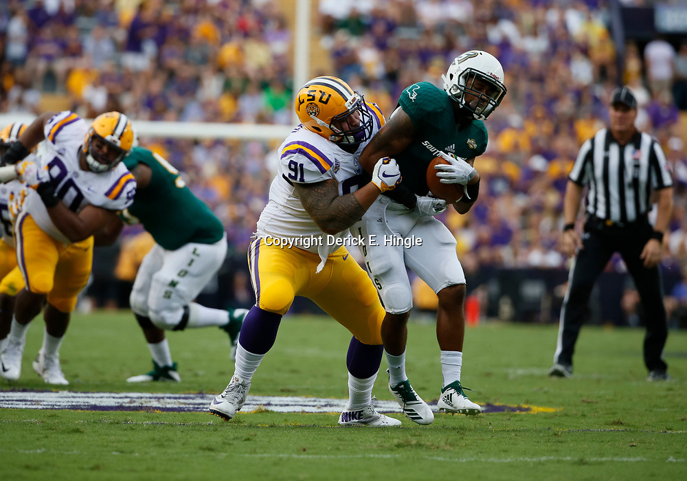 Sep 8, 2018; Baton Rouge, LA, USA; LSU Tigers defensive end Breiden Fehoko (91) tackles Southeastern Louisiana Lions running back Devonte Williams (1) during the first quarter of a game at Tiger Stadium. Mandatory Credit: Derick E. Hingle-USA TODAY Sports