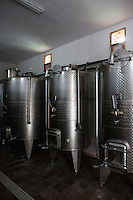 """GORGONA, ITALY - 27 JUNE 2014: Reservoirs of the Gorgona white wine are here in a cellar of the penitentiary in Gorgona, Italy, on June 27th 2014.<br /> <br /> Gorgona is the smallest island of the Tuscan archipelago, located 18 miles west of Livorno, which became an experimental agricultural penal colony in 1869.<br /> <br /> The """"Frescobaldi per Gorgona"""" project  provides inmates the opportunity to learn winemaking techniques and job skills under the supervision of the company's agronomists and winemakers, led by Vice President Lamberto Frescobaldi himself. Fifty inmates contributed to the production of Gorgona, a white wine made from Vermentino and Ansonica grapes planted on the island of Gorgona in the Tyrrhenian Sea, close to the Tuscan coast. The Frescobaldi family purchased a hectare of old vineyards and will expand with more vineyards in the upcoming months. Total production is only 2,700 bottles, but 1,000 of the bottles will reach the US market through Frescobaldi importer Folio Fine Wine Partners, in the Fall.<br /> <br /> Born in August 2012, the Gorgona initiative was financed by the Department of Penitentiary Administration and accomplished through the collaboration of the Gorgona Penitentiary's Directorate and Marchesi de' Frescobaldi."""