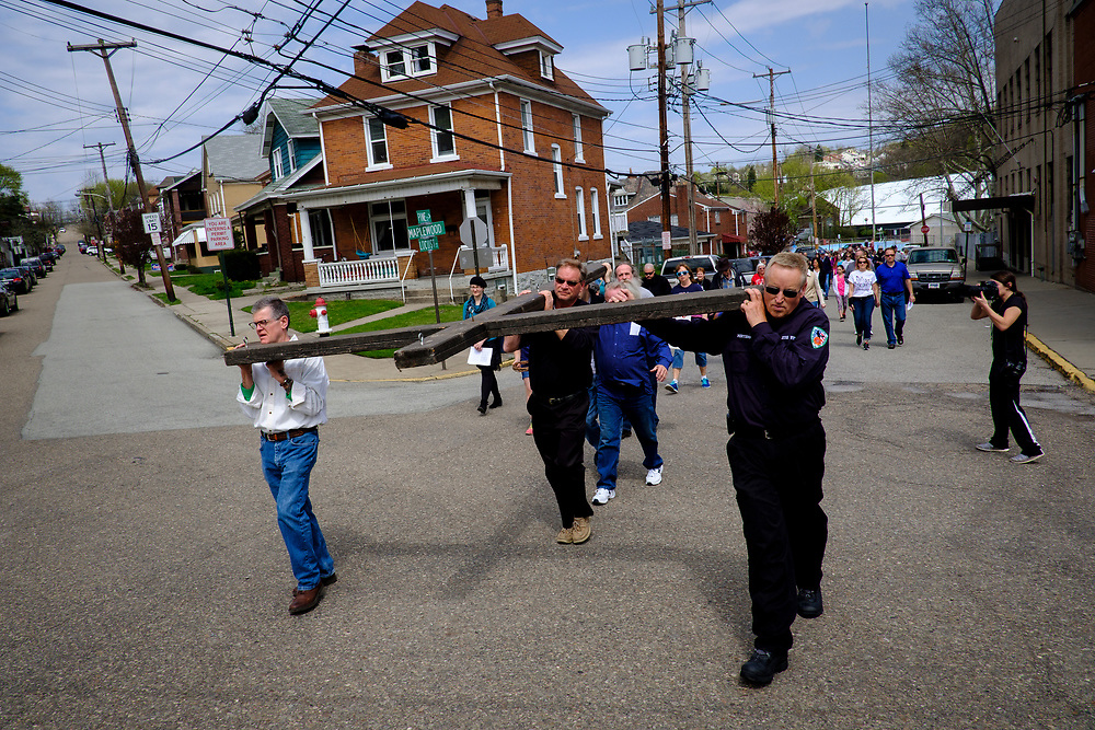 """Christian faithful act out """"The Drama of the Cross"""" in the streets of Etna, Pa. on April 14, 2017, in Etna, Pa."""