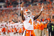 Clemson Tigers quarterback Deshaun Watson (4) gets the crowd pumped before the start of the National Championship game at Raymond James Stadium in Tampa, Monday, January 9, 2017.