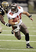 NEW ORLEANS - OCTOBER 10:  Fullback Mike Alstott #40 of the Tampa Bay Buccaneers pounds out some yardage late in the game against the New Orleans Saints at the Louisiana Superdome on October 10, 2004 in New Orleans, Louisiana. The Bucs defeated the Saints 20-17. ©Paul Anthony Spinelli *** Local Caption *** Mike Alstott