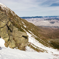 A man snowshoes up the headwall of King Ravine in April.  King Ravine is a glacial cirque on the north side of Mount Adams in New Hampshire's White Mountains.