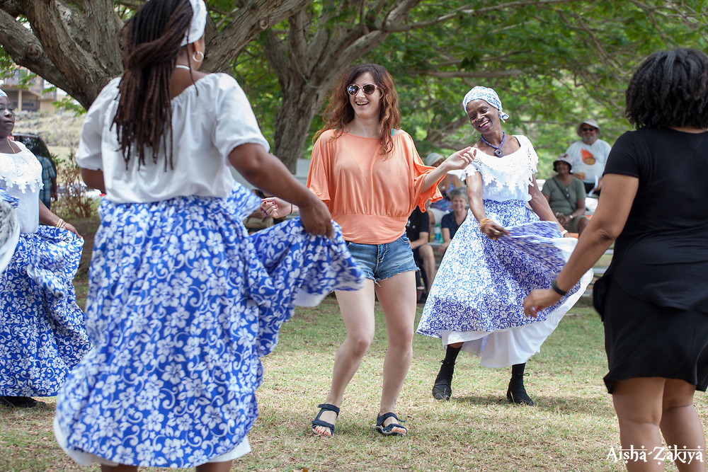 "Magda Murphy, left,  spends part of her honeymoon learning how to dance the Bamboula with Veronica Industrious and the Macislyn Bamboula dancers.  The University of the Virgin Islands hosts ""A Centennial Celebration of Delicacies for the Afternoon on the Green 2017 in celebration of the Virgin Islands Centennial and UVI's 55th anniversary.  Herman E. Moore Golf Course.  University of the Virgin Islands.  19 March 2017.  © Aisha-Zakiya Boyd"