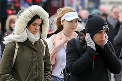 © Licensed to London News Pictures. 13/03/2019. London, UK. Tourists on Westminster Bridge wrapped up warm on a cold and windy day in the capital. Photo credit: Dinendra Haria/LNP