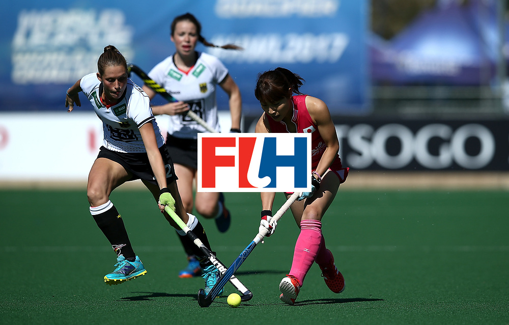 JOHANNESBURG, SOUTH AFRICA - JULY 16:  Minami Shimizu of Japan controls the ball from Cecile Pieper of Germany during day 5 of the FIH Hockey World League Women's Semi Finals Pool A match between Japan and Germany at Wits University on July 16, 2017 in Johannesburg, South Africa.  (Photo by Jan Kruger/Getty Images for FIH)
