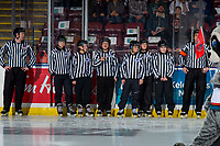 KELOWNA, CANADA - FEBRUARY 2: Young referees stand on the ice with WHL officials at the Kelowna Rockets against the Kamloops Blazers on February 2, 2019 at Prospera Place in Kelowna, British Columbia, Canada.  (Photo by Marissa Baecker/Shoot the Breeze)