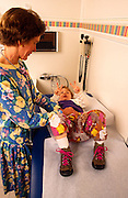 PARTNERS, Catalina Pediatrics, M. E. Cochran, M.D., examines Morgen English, two.©1993 Edward McCain. All rights reserved. McCain Photography, McCain Creative, Inc.