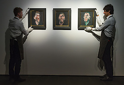 Christie's, London, February 24th 2017. Fine art auctioneers Christie's hold a press preview for their Impressionist and Modern Art and Art of the Surreal sale which takes place on 28th February. PICTURED: Gallery staff hang Three studies for a portrait of George Dyer, Francis Bacon's first ever portrait of his great muse, painted in 1963. The paintings were formerly in the collection of Roald Dahl and appear on the auction market for the first time, with they triptych expected to realise between £50-70million.