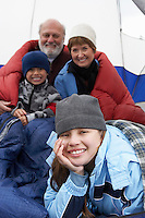 Grandparents and grandchildren (7-12) in tent (portrait)