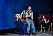 """Mike Rice, waits outside the entrance of the circus tent with his wife Carolyn's dogs and pony she performs with. Carolyn performs as """"Moxie Montana"""" and dons a cowgirl uniform during the Cole Bros. Circus...2009 marks the Cole Bros.'s 125th anniversary and the circus claims to be the oldest American circus under a tent. The 136 x 231 foot tent can house over 2,800 fans, along with several acts where the performers hail from all over the world...These images are from shows in Augusta, Georgia, Thomasville, Georgia and Meridian, Mississippi."""