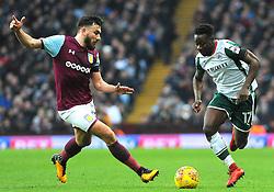 Robert Snodgrass of Aston Villa competes with Andy Yiadom of Barnsley -Mandatory by-line: Nizaam Jones/JMP - 20/01/2018 - FOOTBALL - Villa Park - Birmingham, England - Aston Villa v Barnsley- Sky Bet Championship