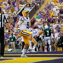 Sep 8, 2018; Baton Rouge, LA, USA; LSU Tigers quarterback Joe Burrow (9) runs for a touchdown against the Southeastern Louisiana Lions during the first quarter of a game at Tiger Stadium. Mandatory Credit: Derick E. Hingle-USA TODAY Sports
