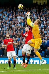 Wayne Rooney of Manchester United collides with Joe Hart of Manchester City - Photo mandatory by-line: Rogan Thomson/JMP - 07966 386802 - 02/11/2014 - SPORT - FOOTBALL - Manchester, England - Etihad Stadium - Manchester City v Manchester United - Barclays Premier League.