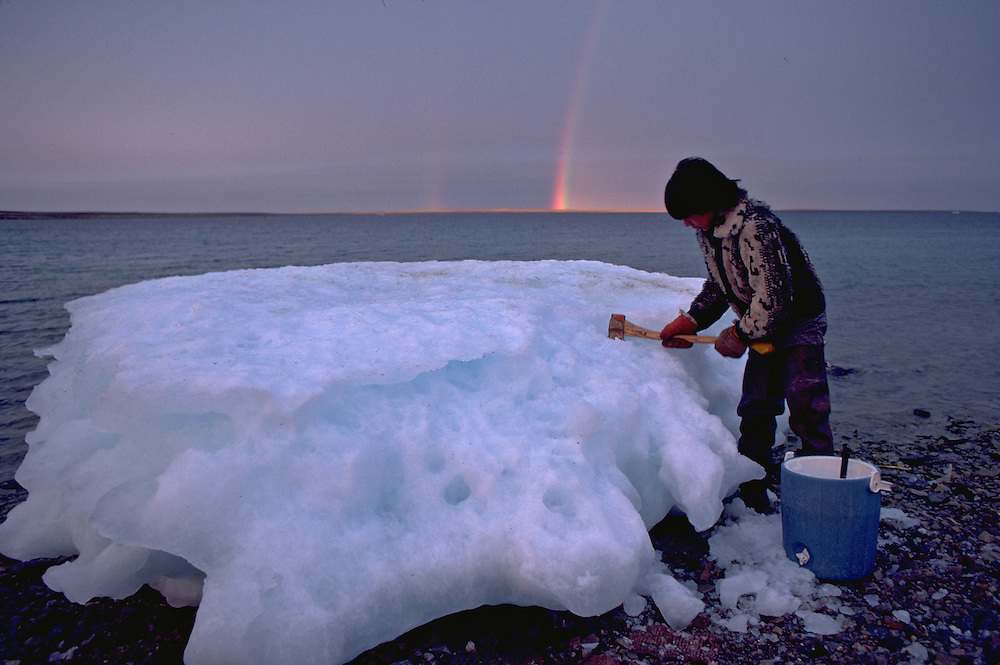 Images from assignment work in Igloolik, Eastern Canadian Artic, in 1985-1986.  Igloolik is an Inuit community with traditional hunting and fishing and a strong sense of self government. Guy Mamatiak chips ice float for drinking water.
