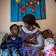 "Atlanta, Georgia/Central Africa Republic Refugee/Nestorine Lakas, 27, with her son Eric, 7, who has cerebral palsy, and her daughter Carol,3, at their apartment in Atlanta. Nestorine arrived in the U.S. in 2010 with her two young children from the Central African Republic. Eric suffers from severe cerebral palsy and requires a wheelchair and specialized healthcare. At the IRC in Atlanta, Nestorine is part of the Temporary Assistance for Needy Families (TANF) program where she is learning English, job skills and basic computer literacy so she can support her family as a single mom and learn how to manage her son's health needs. Unfortunately the father of Nestorine's children was not able to come to the U.S. with her, so she cares for her children and dreams of reuniting with him someday. Nestorine believes what makes her successful is ?working hard and overcoming challenges?. ""There was a war in my country and I fled to Cameroon. I was pregnant with my older son and gave birth along the way. When I fled I was alone. When I got to the camp I found my husbands name on a sign at the camp and we were reunited. My daughter Carol was born in Cameroon."" Because of her son's disability, Nestorine got a humanitarian visa with the help of UNHCR. ""I am very happy to be here because they helped me a lot with my child. If I had stayed in CAR there isn't the healthcare that I have here. I am very thankful. The reason my child is still alive because I came as a refugee. Maybe the child would not have had any hope to walk. I hope one day he might walk."" /UNHCR/E.Hockstein/February 2013"