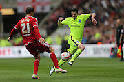 Brighton winger, Jamie Murphy (15) takes on Middlesbrough FC midfielder Gaston Ramirez during the Sky Bet Championship match between Middlesbrough and Brighton and Hove Albion at the Riverside Stadium, Middlesbrough, England on 7 May 2016.