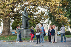 Visitors on a guided tour through old town on Maister Square by the Statue of General Rudolf Maister in Maribor, Slovenia on 27th of September.  Photo by Milos Vujinovic / Sportida