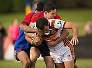 NSW's Keiran Roughly Milton is caught in a tackle during the rugby league match between Upper Central Zone U18 and NSW Country U18, at Puketawhero Park, Rotorua, New Zealand, Saturday 13 July 2013.  Photo: Stephen Barker/photosport.co.nz