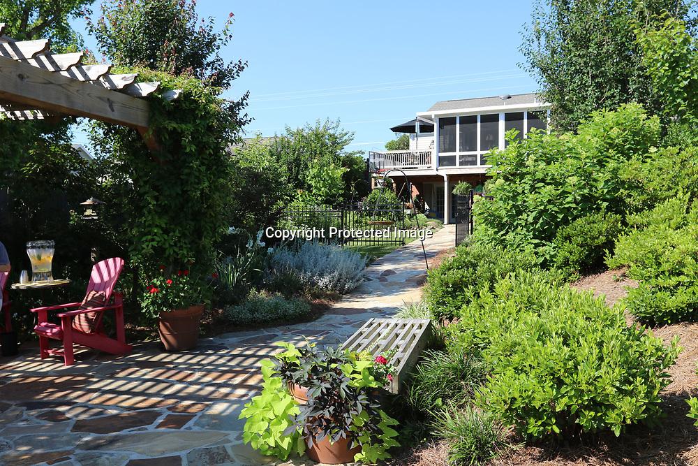 LIBBY EZELL | BUY AT PHOTOS.DJOURNAL.COM<br /> Bonnie Mims backyard is a hidden gem in the Joyner Garden District.