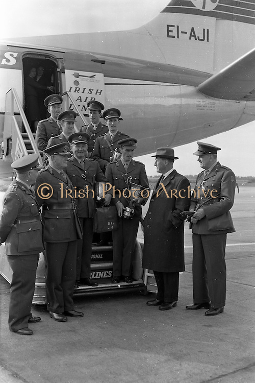 """08/05/1961<br /> 05/08/1961<br /> 08 May 1961<br /> Captain W.A. (Billy) Ringrose (third from right) and the other members of the Army Showjumping team arrive in Dublin Airport after the Captain won the Grand Prix de Roma on the 3rd of May. Captain Ringrose won the competition with the two horses """"Loch an Easpaig"""" and """"Cloyne"""". Captain Ringrose was also presented with a """"Roman Wolf"""" trophy by Queen Elizabeth II, who was on a State visit to Italy, on the 5th May in congratulations on his victory."""