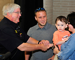 Former Bethlehem Township paramedic AJ Heightman reunites with the Barron Family including Rodney Barron, II (center) who Heightman cared for as a premature baby 27 years ago on April  23, 2017, in Bethlehem Township. Heightman has not seen Barron since he assisted in his care when Barron was born prematurely at home 27 years ago. (Chris Post   lehighvalleylive.com contributor)