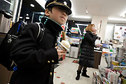 little uniformed school boy holding an ice cream inside a convenient store Japan Tokyo