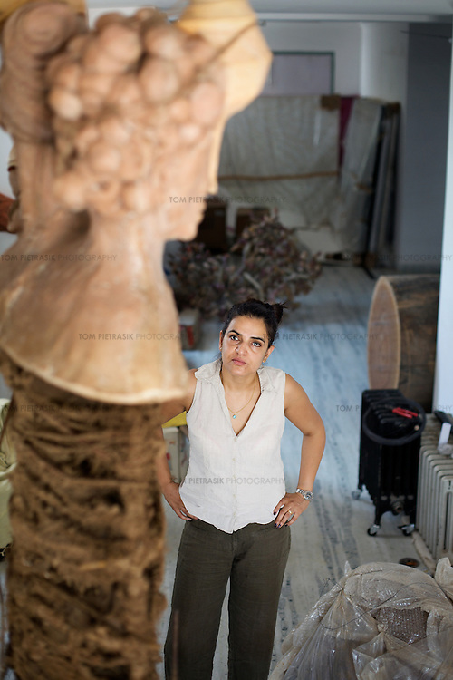 Bharti Kher, contemporary artist in her studio  working on a sculpture. Kher is based in Gurgaon, a satellite town of Delhi and is married to artist Subodh Gupta...Photo: Tom Pietrasik.Gurgaon, Haryana. India. .June 26th 2009