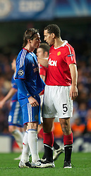 06.04.2011, Stamford Bridge, London, ENG, UEFA CL, Viertelfinale, Hinspiel, Chelsea FC (ENG) vs Manchester United (ENG), im Bild Chelsea's Fernando Torres clashes with Manchester United's Rio Ferdinand during the UEFA Champions League Quarter-Final 1st leg match at Stamford Bridge, EXPA Pictures © 2011, PhotoCredit: EXPA/ Propaganda/ D. Rawcliffe *** ATTENTION *** UK OUT!