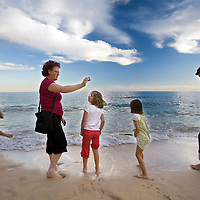Family members enjyoing a beach, town of Porches, municipality of Lagoa, district of Faro, region of Algarve, Portugal