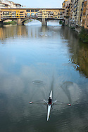 Rowing scull in the Arno River, Florence, Italy.
