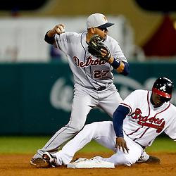Mar 7, 2013; Lake Buena Vista, FL, USA; Atlanta Braves left fielder Justin Upton (8) is forced out as Detroit Tigers shortstop Jhonny Peralta (27) turns a double play during the bottom of the fourth inning of a spring training game at Champion Stadium. Mandatory Credit: Derick E. Hingle-USA TODAY Sports