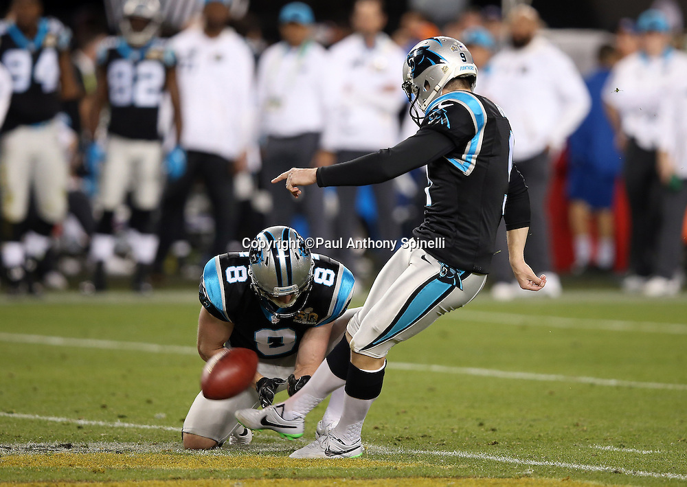 Carolina Panthers punter Brad Nortman (8) holds while Carolina Panthers kicker Graham Gano (9) kicks a 39 yard fourth quarter field goal that cuts the Denver Broncos lead to 16-10 during the NFL Super Bowl 50 football game against the Denver Broncos on Sunday, Feb. 7, 2016 in Santa Clara, Calif. The Broncos won the game 24-10. (©Paul Anthony Spinelli)