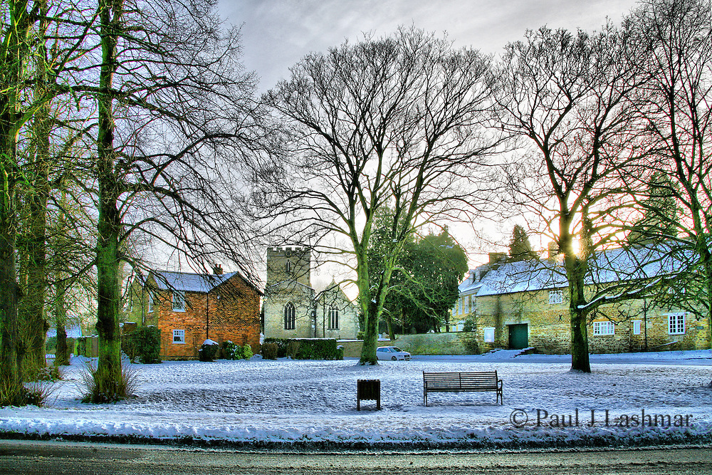 St Botolphs, Barton Seagrave and the village green finally sees some sun after a week of snow filled skies