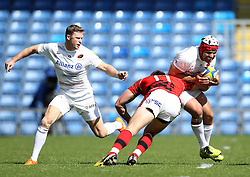 Saracens Schalk Brits is tackled by London Welsh's Chris Elder - Photo mandatory by-line: Robbie Stephenson/JMP - Mobile: 07966 386802 - 16/05/2015 - SPORT - Rugby - Oxford - Kassam Stadium - London Welsh v Saracens - Aviva Premiership