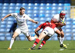 Saracens Schalk Brits is tackled by London Welsh's Chris Elder - Photo mandatory by-line: Robbie Stephenson/JMP - Mobile: 07966 386802 - 16/05/2015 - SPORT - Rugby - Oxford - Kassam Stadium - London Welsh v Saracens - Aviva Premiership