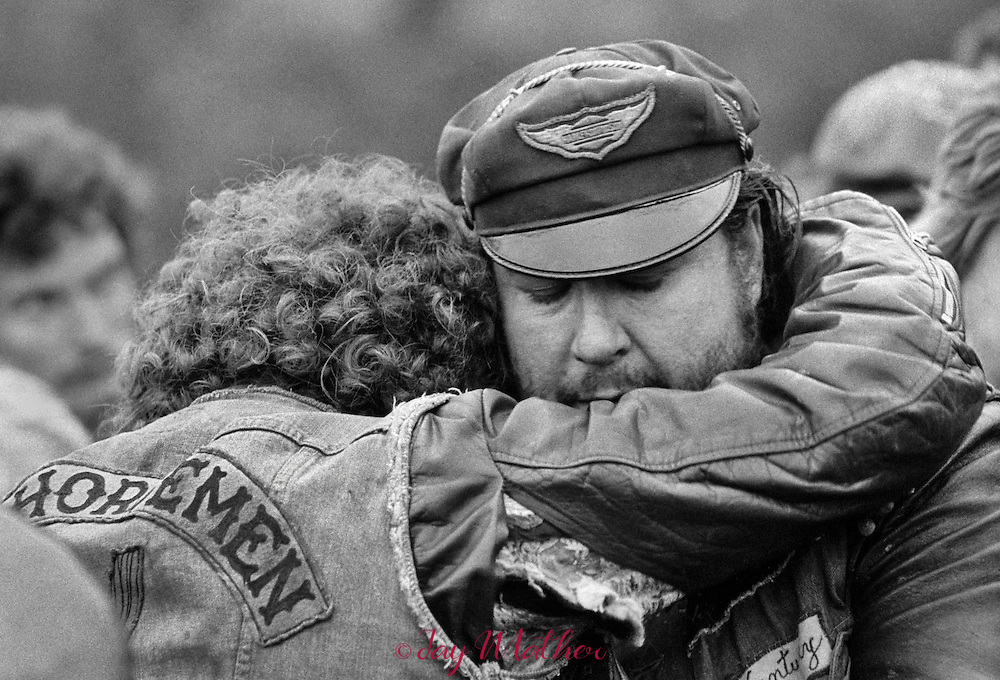 Jack (Henchman Bear) Schmidt, the new president of the Iron Horseman, comforts another club member at the graveside.<br />