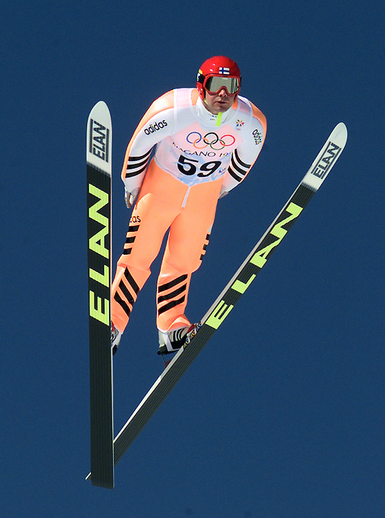 1998 Winter Olympics -- Nagano, Japan -- Finland's Jani Soininen competes in the first round of the men's K90 ski jump Wednesday morning.
