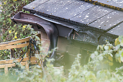 © Licensed to London News Pictures . 23/10/2014 . Penistone , UK . Melted gutter at the house . A fire in a house on Tennyson Close in Penistone near Barnsley has killed a nine year old boy and a 44 year old man and a boy aged 11 is critically ill in hospital . The house ( pictured with solar panels on the roof and smashed windows ) is cordoned off by police . Photo credit : Joel Goodman/LNP