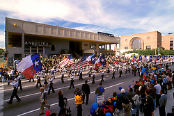 Stock photo of a parade through the theater district in downtown Houston Texas