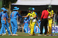 Australian players and Indian players shake hands after the first women's one day International ( ODI ) match between India and Australia held at the Reliance Cricket Stadium in Vadodara, India on the 12th March 2018<br /> <br /> Photo by Vipin Pawar / BCCI / SPORTZPICS