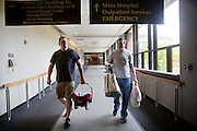 Justin Karas and Jason Holling leave Edwards Hospital with their newborn daughter Abby on August 29, 2014 in Naperville, Il.