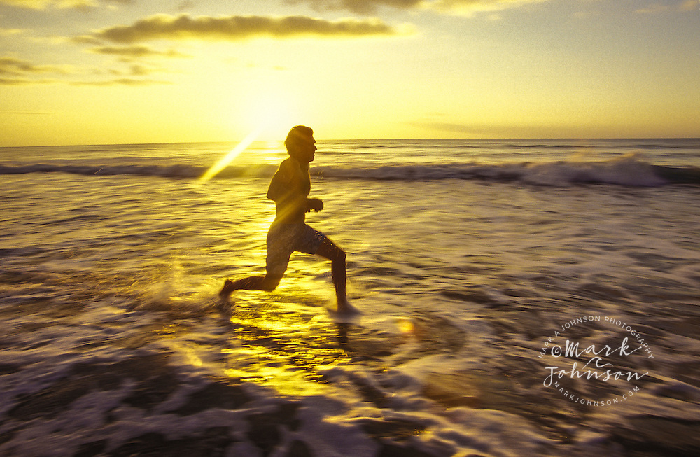 Man running in the surf
