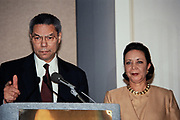 Former U.S. Army General Colin Powell and his wife Alma announce that he will not be running for the 1996 presidential election during a news conference November 8, 1995 in Alexandria, Virginia.