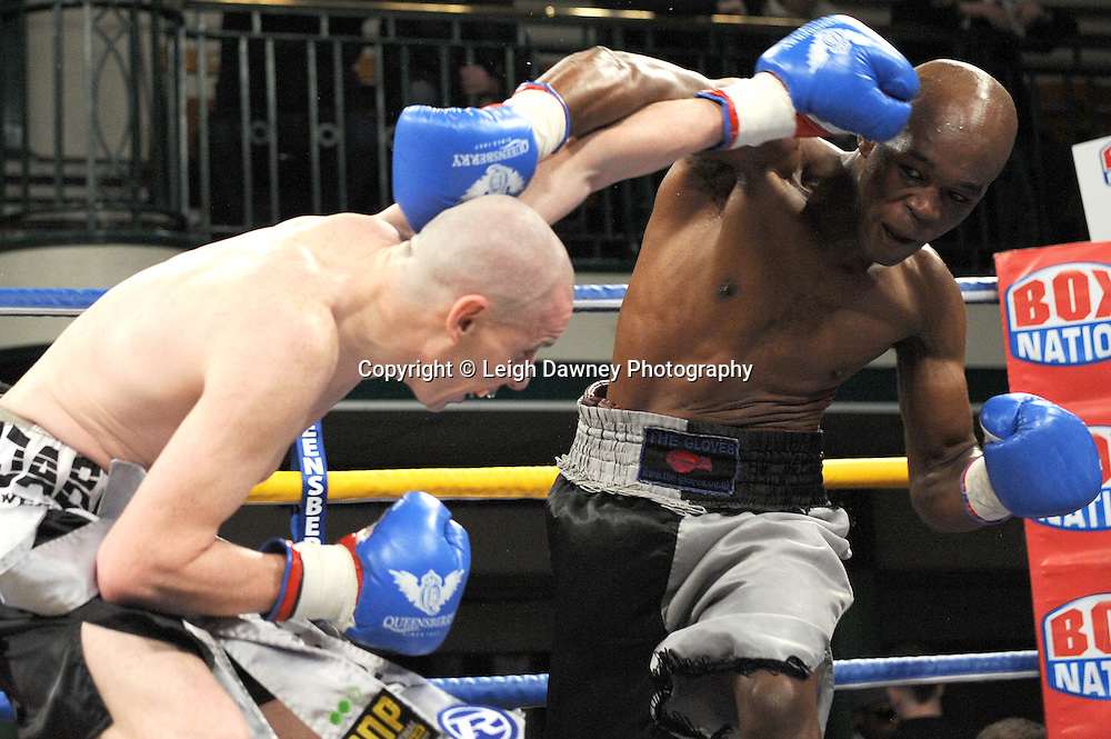 Peter McDonagh (silver/black shorts) defeats Jason Nesbitt in a 6x3 min Welterweight contest at York Hall, Bethnal Green, London on Friday 13th January 2012. Queensbury Promotions © Leigh Dawney 2012