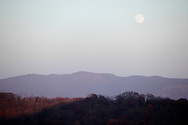 Salisbury Mills, New York - An almost full moon rises above the Hudson Highlands on Nov. 20, 2010.