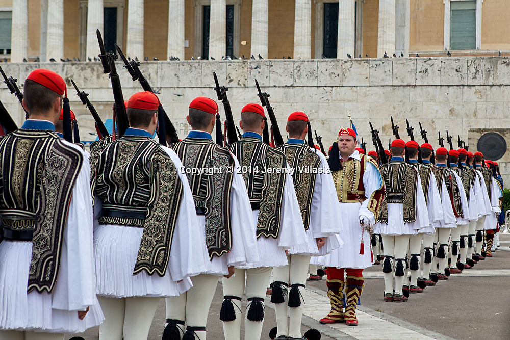 Evzones during the Changing of the Guard ceremony in front of the Old Royal Palace in Syntagma Square, Athens. The official ceremony is held every Sunday at 11 AM.