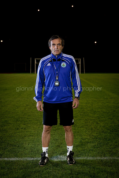 SAN MARINO, SAN MARNO - 3 OCTOBER 2011: Giampaolo Mazza, 55, coach of the San Marino national team,  poses at the Olympic Stadium before the upcoming and last Euro 2012 qualification game against Moldova on October 11, in San Marino on October 3, 2011. Giampaolo Mazza works as a physical education teacher at the San Marino junior high-school. Non The San Marino national football team is the last team in the FIFA  World Ranking (position 203). San Marino, whose population reaches 30,000 people, has never won a game since the team was founded in 1988. They have only ever won one game, beating Liechtenstein 1&ndash;0 in a friendly match on 28 April 2004. The Republic of San Marino, an enclave surronded by Italy situated on the eastern side of the Apennine Moutanins, is the oldest consitutional republic of the world<br /> <br /> <br /> ph. Gianni Cipriano